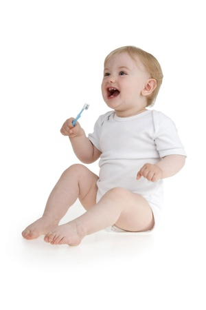 Dinky little girl with toothbrush on white background.  photo