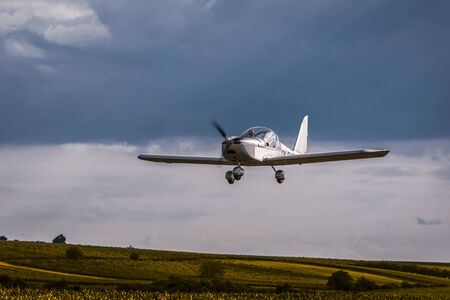 airplane ultralight: Ultralight airplane during landing at a village small airfield