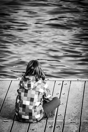ponton: Young girl watching river floating in front of her