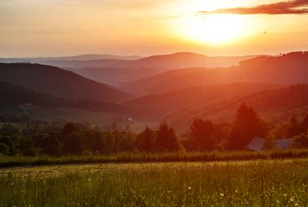 Morning in mountains with Sun rising rural scenery photo