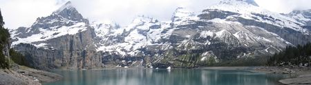 steely: Oeschinensee lake from the shore - Alps - Switzerland - Panorama.