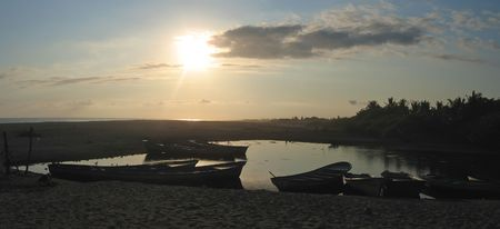 Small fisherman boats on the sunset in Laguna Ventanilla - Puerto Angel - Mexico - Panorama. photo