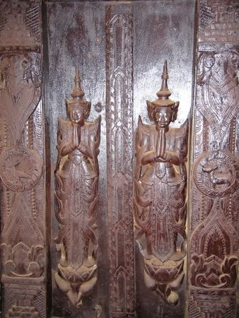 4 door: Wood statues - Mandalay - Myanmar.