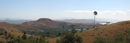 Large view of the Rinca island and its mountains - Komodo archipelago - Indonesia - Panorama. photo