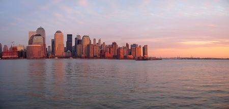 Scrape sky building shore line at the sunset from a boat - New York - Panorama.