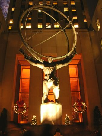 manhattans: Artistic work - Powerfull man raising a planet - New York. Stock Photo