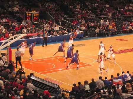 central square: Basket Ball match in a stadium - Madison Square Garden - New York.