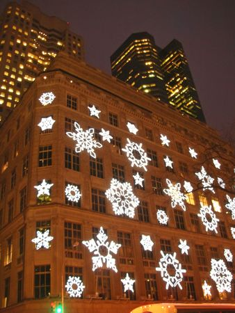 manhattans: Christmas show with snow flake on a front building - New York.