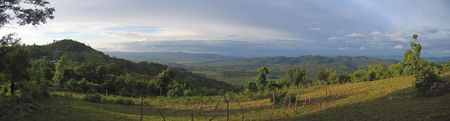 Large view on the valley with ricefields and rich ground - Kalaw - Myanmar - Panorama.