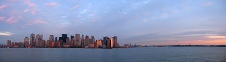 sea life centre: Scrape sky building shore line at the sunset from a boat - New York - Large Panorama.