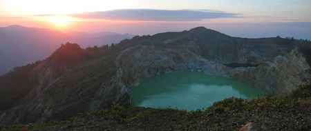 Sunrise on the crater lake - Kelimutu volcano - Flores - Indonesia - Panorama. Stock Photo