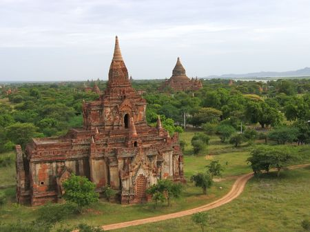 dull: Landscape view with the river and two buddhist temples - Bagan - Myanmar. Stock Photo