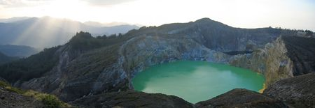 Sunlight on the green crater lake - Kelimutu volcano - Flores - Indonesia - Panorama.