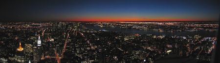 View on all the city by night from the  Empire State Building - New York - Panorama.