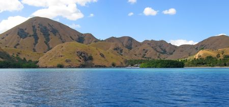 Yellow mountains falling on the sea of Komodo archipelago - Indonesia - Panorama. photo