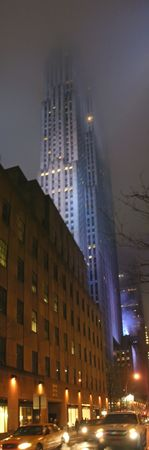 manhattans: Active street and still tower in blue fog - New York - Panorama. Stock Photo
