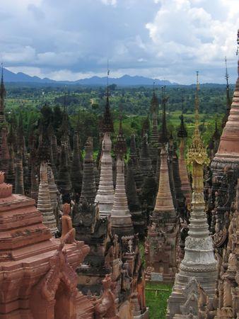 View of the stupas over the jungle - Kakku - Myanmar. photo
