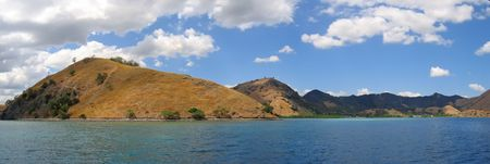 steely: Yellow mountains falling on the sea - Komodo archipelago - Indonesia - Panorama.