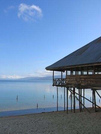 Lake with clear water and a house with pile - Poso lake - Sulawesi island - Indonesia.