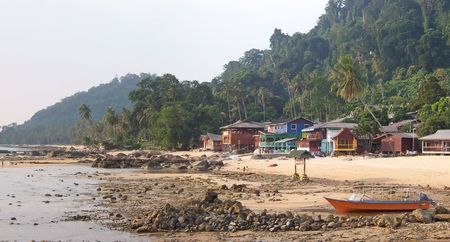 Rocky tropical beach with some resorts - Tioman islands - Malaysia - Panorama. photo