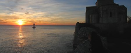 Sunset at the Talmont church with a sailing boat - France - Panorama. photo