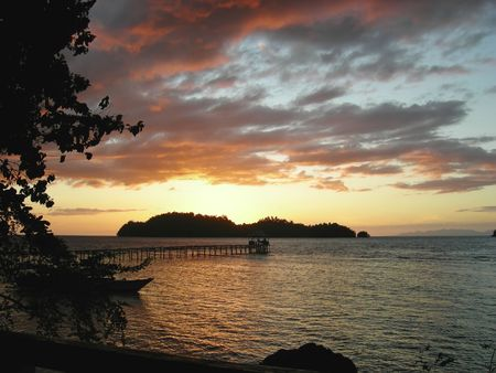 Sunset over a tropical beach - Togians island - Sulawesi - Indonesia. photo