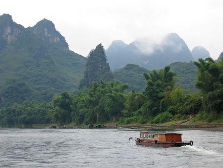 Small boat on the Li Jiang river - Guilin - China. photo