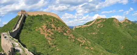 The Great Wall of China ond the mountains - China - Panorama. photo