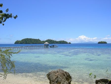 Boat on the pier of a tropical beach - Togians island - Sulawesi - Indonesia. photo