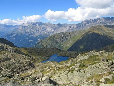 Small lake and the mountains - Aiguillette des Houches - Brevent - France - The Alps. photo