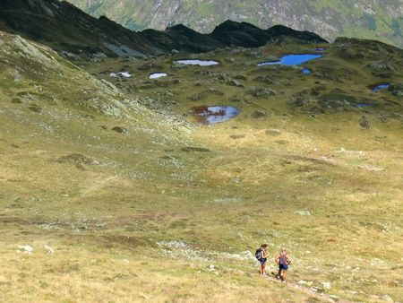 Small trekkers in big mountains with many lakes - Aiguillette des Houches - Brevent - France - The Alps. photo