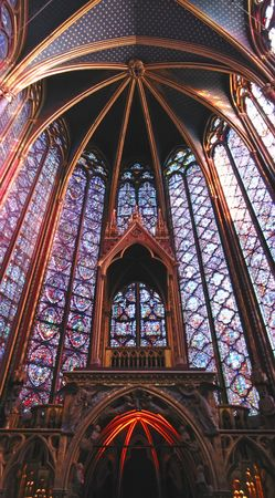 Stained glass windows of the choir in a church - Sainte Chapelle - Notre Dame de Paris - Paris - France - Vertical Panorama. Stock Photo