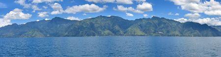 Lake with volcanos in the background - Lake Atitlan - Guatemala - Panorama.