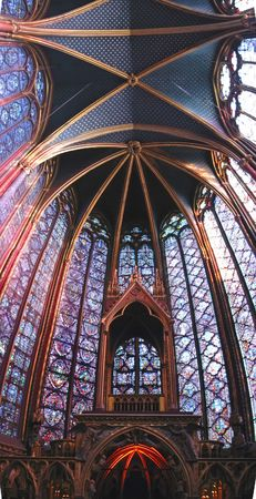 Stained glass windows of the choir in a church - Sainte Chapelle - Notre Dame de Paris - Paris - France - Panorama. Stock Photo