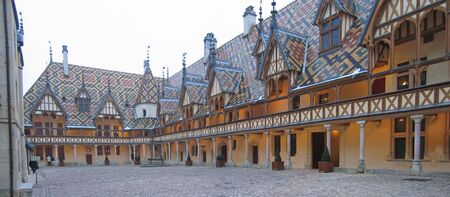 Main place - Beaune old hospital - France - Panorama. Stock Photo