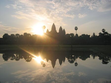 Sunrise on the imperial old khmer city with the sun - Angkor Vat - Angkor temples - Cambodgia. photo