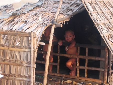 Small naked   under a hut - Tonle Sap lake - Cambodgia. photo