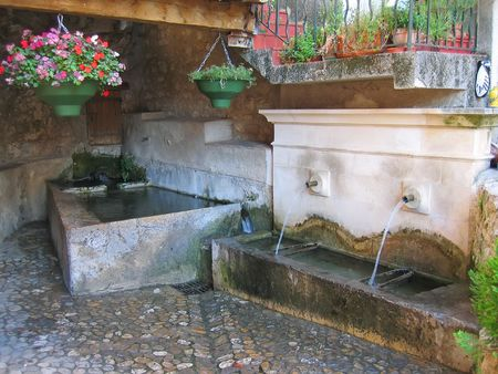 azur: Water fountain in provencal style - Azur coast - South of France. Stock Photo