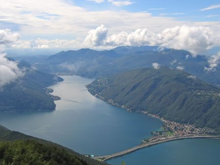 Aerial view of a lake between the small Alps mountains - Come lake - Italia. photo