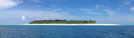 Blue see and white sand of the Mnemba atoll - Zanzibar - Tanzania - Panorama.