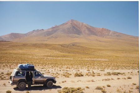 Four wheels jeep stopped in the desert - Uyuni - Bolivia. photo