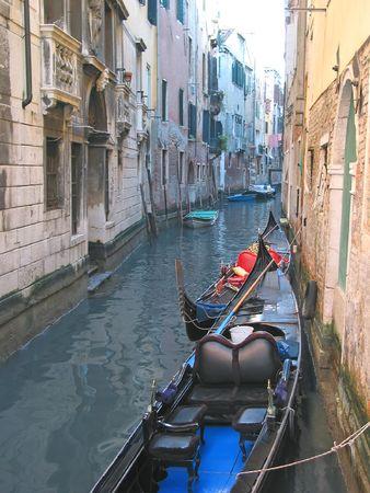 Gondola on a small water canal - Venice - Italia. photo