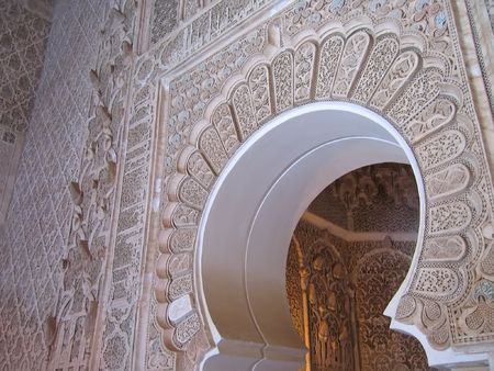 Oriental architecture with azulejos and painted stuc on a door - Ben Youssef medersa  - Marrackech - Morocco.