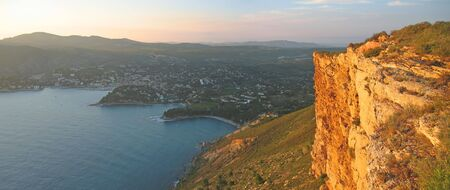 Wild red rocks of the cliff of Canaille cap and Cassis city behind - Marseille - South of France - Panorama. photo