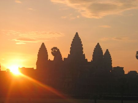 appearing: Sunrise on the imperial old khmer city with the sun just appearing - Angkor Vat - Angkor temples - Cambodgia.