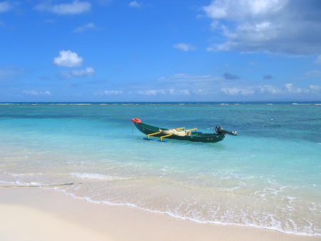 steely: Blue sea with a small motor boat - Nosy Boraha - Sainte-Marie island - Madagascar.