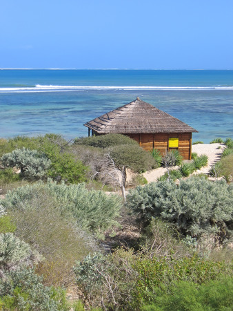 Bungalow in the desert in front of the sea - Anakao - Madagascar. Stock Photo