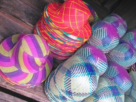 Colored hat on a market stand - Ambositra - Madagascar.