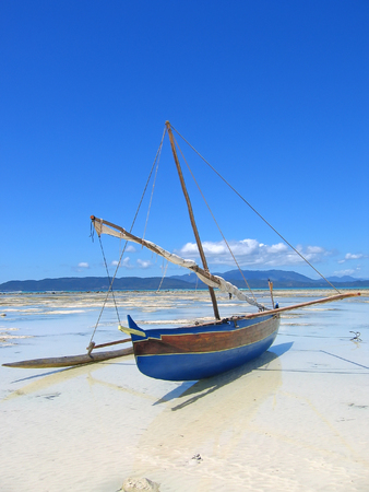 Detail of a fisherman boat standing on a beach - Nosy Iranja - Nosy Be island - Madagascar. photo