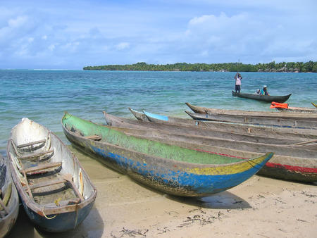 Many small boats on the Nattes island sand beach - Nosy Boraha - Sainte-Marie island - Madagascar.